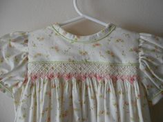 Smocking is a type of embroidery which gathers fabric so that it can stretch. It used to be used commonly before elastic became common. Now, it is consider