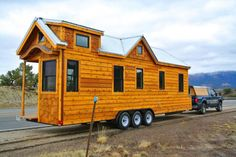 This may be the largest tiny house on wheels we've seen, and it's packed with great design features, including two lofts, a murphy bed, stairs and tons of storage. Read moreSuperb Craftsmanship Defines This Tiny House on Wheels Tiny House Big Living, Modern Tiny House, Tiny House Design, Cottage Living, Tiny House Trailer, Tiny House Plans, Tiny House On Wheels, Tiny House Movement, Tiny House Mobile