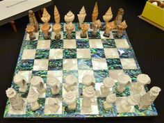 Seashell chess with nautical passion.