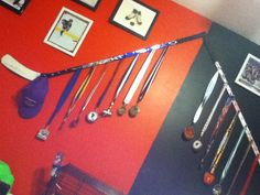Good way to show your old medals, with your old hockey sticks!