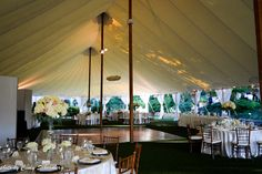 Elegance added to the Sperry tent by draping the poles in fabric | Keswick Vineyards