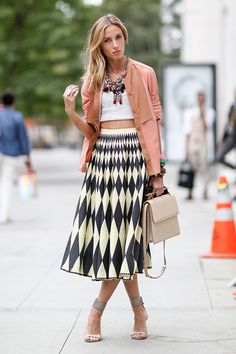 Best #streetstyle @ Spring 2015 Ready-to-Wear #NYFW | a salmon silk blazer thrown over a white crop top and a geometric print black & white mini skirt, styled with ankle strap sandals, a Mulberry beige satchel and a statement necklace