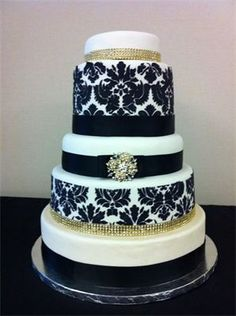 Dramatic wedding cake with gold damask and gold accents by Chrissy Cakes