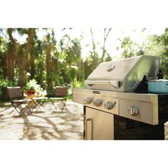 The perfect support for your outdoor cooking, this mid-size KirchenAid grill comes complete with three stainless steel burners with angled porcelain flame tamers for even heat distribution. Cook your favorite griller to perfection with the accuracy of individual burners that have continuous electronic ignition. And serve up flavorful side dishes thanks to the brass ring side burner. You will enjoy using this grill for seasonal and year-round entertaining.