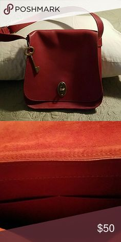 Fossil Red Leather Shoulder Bag Red leather Fossil shoulder bag with gold turn clasp and large key on chain.  Strap is not long enough for crossbody but bag is perfect to carry a mini iPad, Nook or Kindle.  Inside is red suede with two pockets. Fossil Bags Shoulder Bags