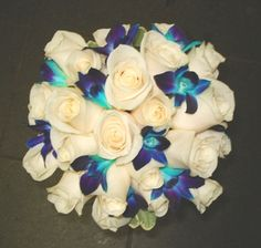 White Rose & Blue Orchid Bouquet add rhinestones, and feathers and this is what my flowers will look like. Blue Orchid Bouquet, White Rose Bouquet, Blue Orchids, White Roses, Blue Flowers, Pink Roses, Orange Roses, Beautiful Flowers, Blue Wedding