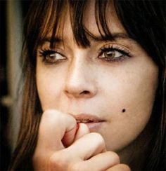 """Although the """"beauty mark"""" seen here on Chan Marshall, aka Cat Power, is fake, I've got a real flat mole/beauty mark on my face. It's located on the lower right side of my cheek, a bit further down from where Chan's fake one would be. It's another distinctive physical feature."""