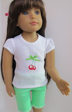 White embroidered cherry tee and green cut offs by MarysPintsizedPieces on Etsy. Made from the LJC T-Shirt Variations and Jeans Bundle for KNC Dolls patterns. Get them at http://www.pixiefaire.com/products/t-shirt-variations-for-kidz-n-cats-dolls. http://www.pixiefaire.com/products/jeans-bundle-for-kidz-n-cats-dolls. #pixiefaire #libertyjane #tshirtvariationsforkidzncatsdolls #jeansbundleforkidzncatsdolls