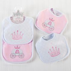 "Little Princess Bibs: Sometimes, even little princesses need help at meal time. On these adorned bibs, a darling princess pink crown and a charming pink and white carriage keep baby girl's frilly frocks ready for the ball. Just another royal addition to Baby Aspen's ""Little Princess"" Collection!"
