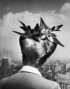 """From the August 1943 photo essay """"Dog-Day Hair-Dos: Amateur vs. professional ways of achieving a summer coiffure."""" This particular style is called """"Winged Victory"""" - and was a popular wartime hairstyle. (Nina Leen—The LIFE Picture Collection/Getty Images) Steampunk Hairstyles, 1940s Hairstyles, Wedding Hairstyles, Homecoming Hairstyles, Party Hairstyles, Long Hairstyles, Natural Hairstyles, Winged Victory, Mode Costume"""