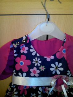 The baby' christening dress with snap fastenings and bolero