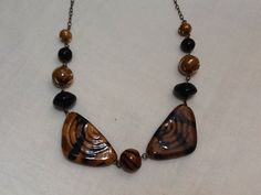 A personal favorite from my Etsy shop https://www.etsy.com/listing/231037225/kazuri-bead-necklace-africa-fair-trade