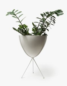 From Hip Haven, a classic bullet planter in White. Featuring a steel tripod stand with powder-coated white finish and compression-molded fiberglass bowl.  • Bullet planter in White • Steel tripod stand • Powder-coated white finish • Compression-molde