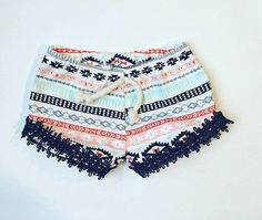 Really cute Aztec shorts with a navy trim . Made with cotton and a cotton cord accent!  Sizes newborn to 24 months Might be able to do larger sizes