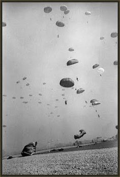Robert Capa. Surreal, a fine art in the midst of war and strife.  The lengths Capa went to make great pictures is amazing.  He was unarmed in the midst of danger, and I don't know, but I assume he parachuted down as well. . .awesome commitment!