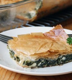 Spanakopita - thin crispy, flaky pastry with savory filling.  So greek and so good.