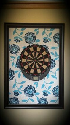 Fabric frame behind the dart board to protect the wall