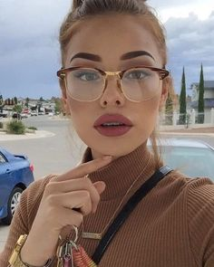 Love her glasses.