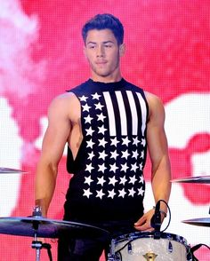 When he wore this American tank top and his arms bulged out like two robust bald eagles emerging from the nest to fly strong and free. | 18 Times Nick Jonas's Arms Literally Changed The World
