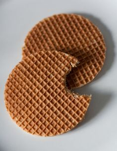 STROOPWAFEL ~~~ this delicious treat is made from two thin layers of baked dough with a caramel-like syrup filling in the middle. they are especially yummy when placed on top of a hot drink for a minute or two. large versions are sold in the streets as a snack. [Netherlands, Gouda] [sprinklebakes]