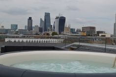 Hot tub on roof terrace with views over London's skyline