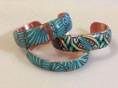 Polymer clay over copper, cuff bracelets by K. Brueggemann