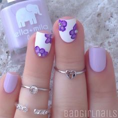 "Dreamiest purple ever floral mani featuring @ellamilapolish ""Lilac Luster"" and @ellamilapolish ""Pure Love"" (white) the flowers were painted using polish and my @stylishnailartshop Edinburg Realism 15 brush"