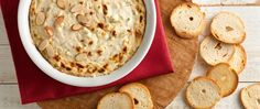 A mixture of creamy cheeses, sweet crabmeat, pungent spices and toasted almonds, this crab dip can't be beat.
