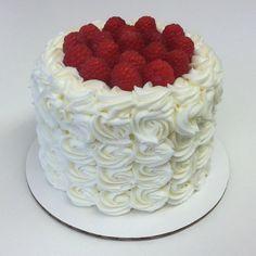 Vanilla & Lemon cake with fresh Raspberries. Available now at FlourGirl/Funky Cookie Studio. #flourgirlpatissier #doorcounty #sisterbay #funkycookiestudio #doorcountycake #raspberries #lemon