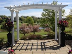Wedding Pergola with large bright colored flower arrangements
