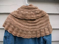 A large crescent-shaped shawl worked from the top down with a lot of texture. A very simple knit that looks great when finished!