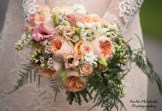 Natural hand-tied bouquet with peach David Austin Juliet Roses, peach Lisianthus, Sweet Sarah Spray Roses, Kalanchoe, white Lilac and Asparagus Fern
