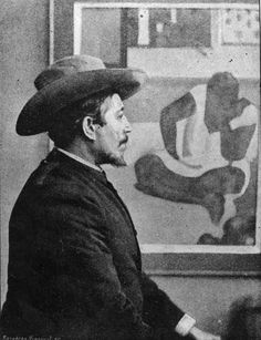 Paul Gauguin - early 1890s - seated in front of one of his paintings.