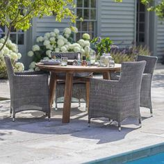 Round St Mawes Garden Table in Reclaimed Teak with Chairs