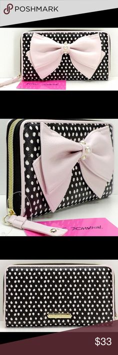 "Betsey Johnson Pink bow zip around wallet 💕 Authentic Betsey Johnson Zip Around Wallet in a black and white dot print with a light pink bow and white faux pearl accents. Faux leather style  Brand New With Tags Closure: Zip around. Hardware: Goldtone Measurements: 7.75"" L x 1.25"" D x 4.25"" H Interior Description: Fully lined in black and multi floral signature fabric and gold metallic. Interior Details: One zip coin pocket, two gusset pockets, two billfold pockets, eight card pockets, one…"