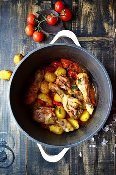 Chicken drumsticks with potatoes and sweet tomatoes