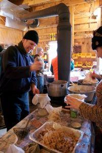 Straining lard into jars at Snake River Farm Minnesota, from One tomato, two tomato.