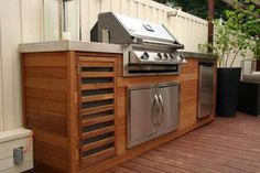 built in bbq. Download onto bench very smart. Like the timber panelling
