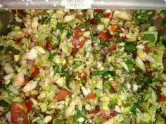 This pico de gallo combines cabbage, red onion, and tomatoes, along with cilantro, lime juice, pickled jalapenos, vinegar, ground red pepper, and chili powder.