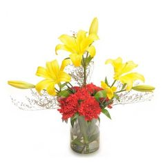 Check out our New Product  Carnations N Lilies Mothers Day Glass Vase arrangement of 6 red carnations and 2 yellow lilies.  Rs.856