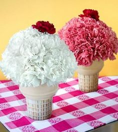 LOVE!- use small clay pots from michaels and paint them like a cone and then use carnations to make an icecream ball and then one red carnation for the cherry - perfect decor!