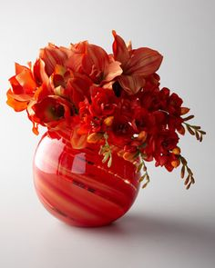 """Orange Sherbet"" Faux Floral Arrangement by John-Richard Collection - Bright red-orange faux floral arrangement of amaryllis and freesia is held in a round glass vase with swirled pattern Faux Flower Arrangements, Vase Arrangements, Floral Centerpieces, Centrepieces, Faux Flowers, Orange Flowers, Silk Flowers, Round Glass Vase, Amarillis"