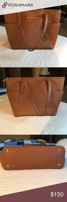 Michael  Kors Jet Set Tote Amazing outside! Only flaw is in the last pic with a small stain on inside. Price negotiable! 15 1/2 W x 10' x 4 1/2 D Michael Kors Bags Totes