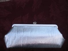 Silver Clutch @Etsy AffodableGlam shop $18.50.  This would be great for the upcoming holidays, nice size :)