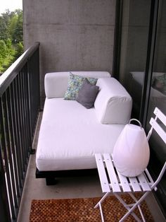 Pleasing Small Balcony With Mini Garden Decorating Ideas With Long And Large Sofa Featuring One Small Chair And Standard Iron Rail