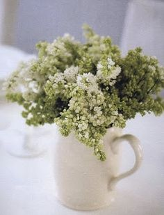 pitcher of white lilacs