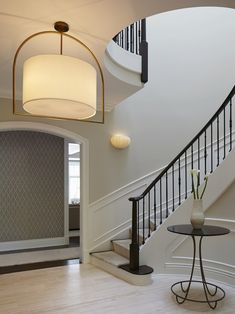 Foyer (Staircase Hall) With Curved Stairs & Light Hardwood Flooring Foyer Staircase Architectural Detail Design Detail Architectural Details Modern Transitional by Reynolds Architecture, Design & Construction