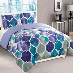 Update your bedroom with the Emmi Comforter Set for a modern look. The trendy comforter set is decorated with a beautiful trellis pattern in a vibrant purple and teal watercolor print that is sure to liven up any room.