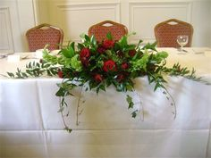 long and low top table arrangement red roses - Google Search
