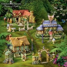 Fairy village buildings inspired by Thomas Kinkade's artwork, each with a FREE sculpted fairy and accessory hand-painted with UV-resistant paint.